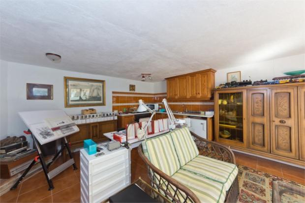 Apartment living area + kitchen