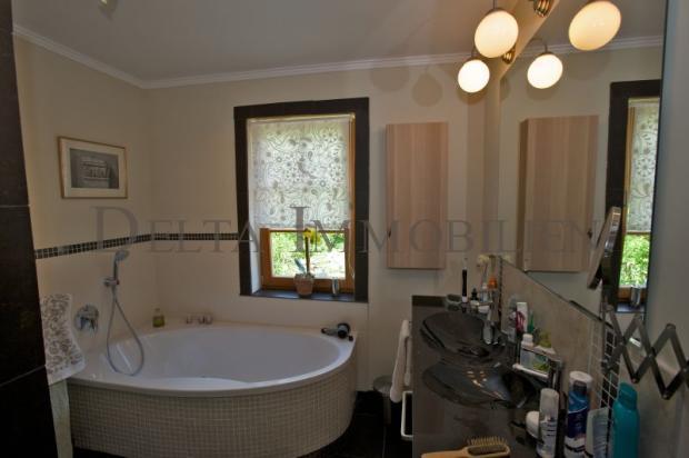 Tiled bathroom with corner bath