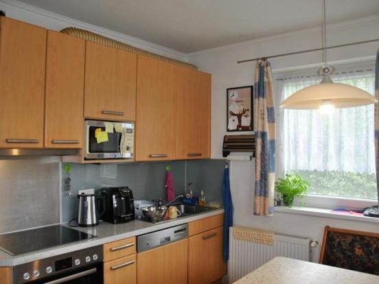Fitted kitchen with dining area