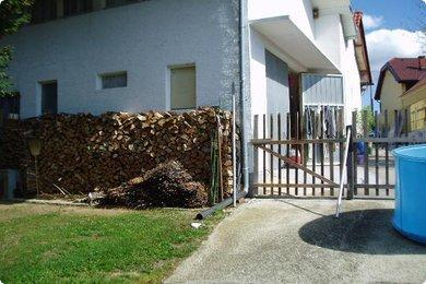 Garage and wood pile