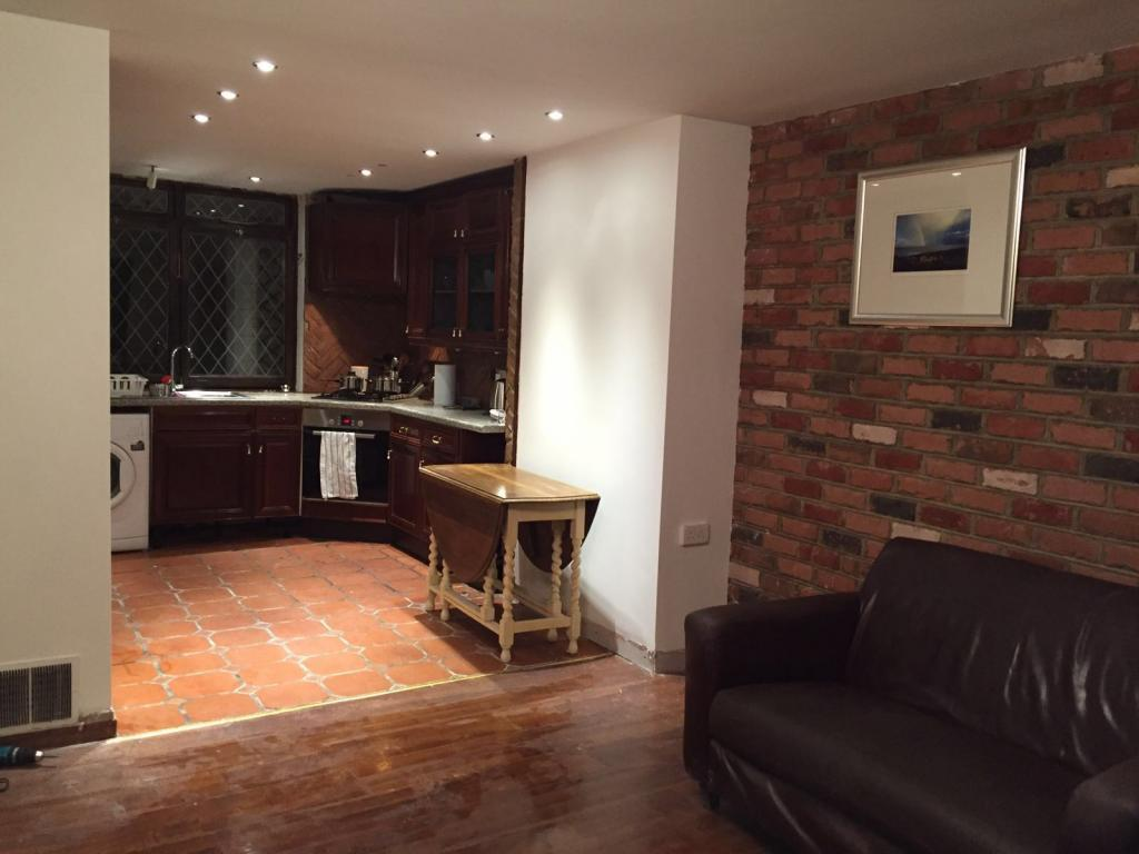open plan living room leading to kitchen/dinning r
