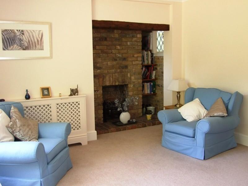 photo of beige blue lounge with inglenook fireplace