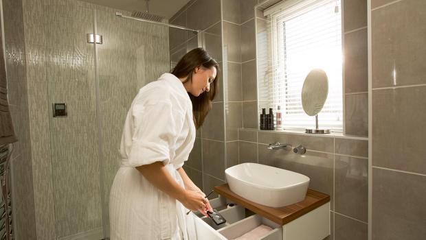 Luxurious en suite full height tiling