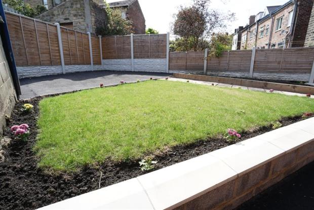 REAR GARDEN WITH DRIVEWAY