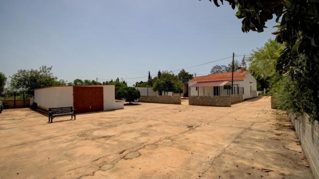 Parking area, garages and house