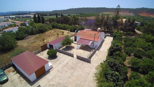 Garages, courtyard, house and garden