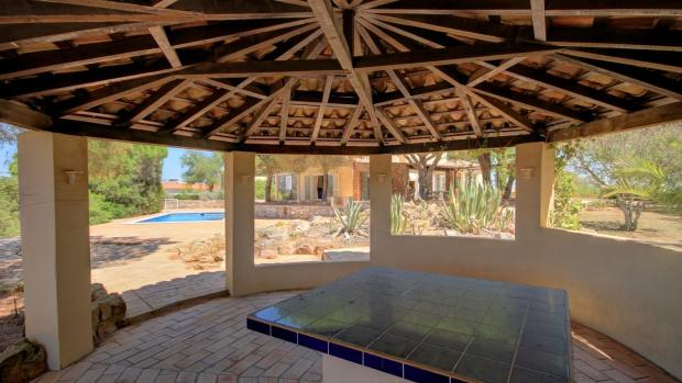 covered entertainment area near pool