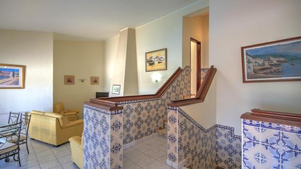 Stairs up to bedrooms & down to lower floor