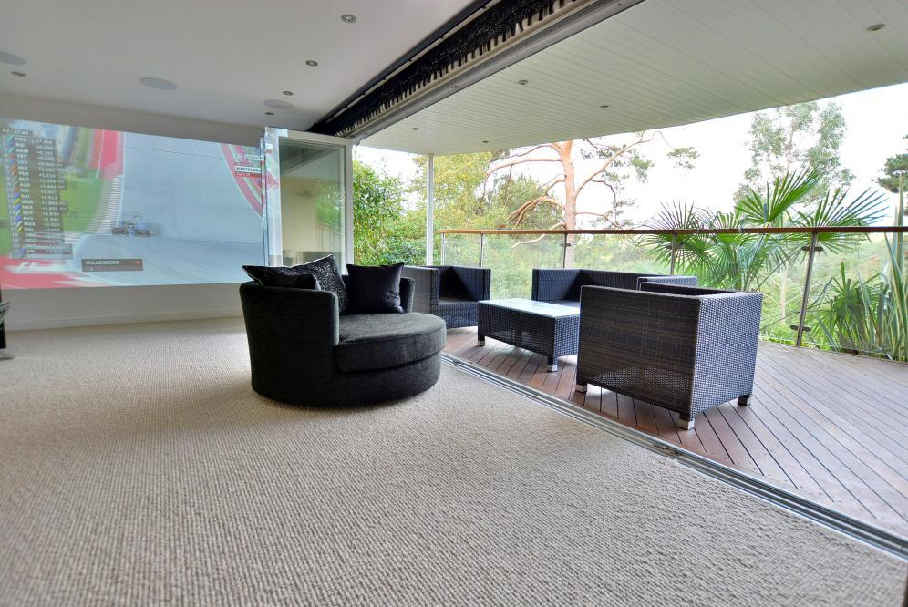 Cinema/sitting room and balcony