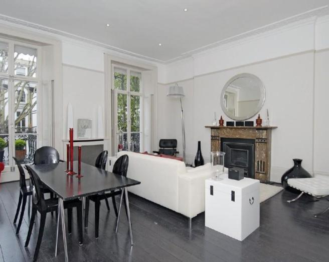 photo of contemporary modern open plan white dining room living room lounge with exposed floorboards floorboards