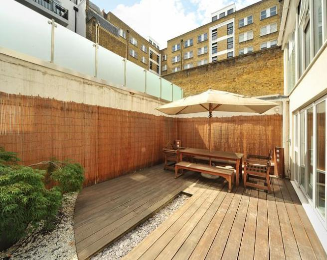 photo of low maintenance gravel garden and decking urban garden