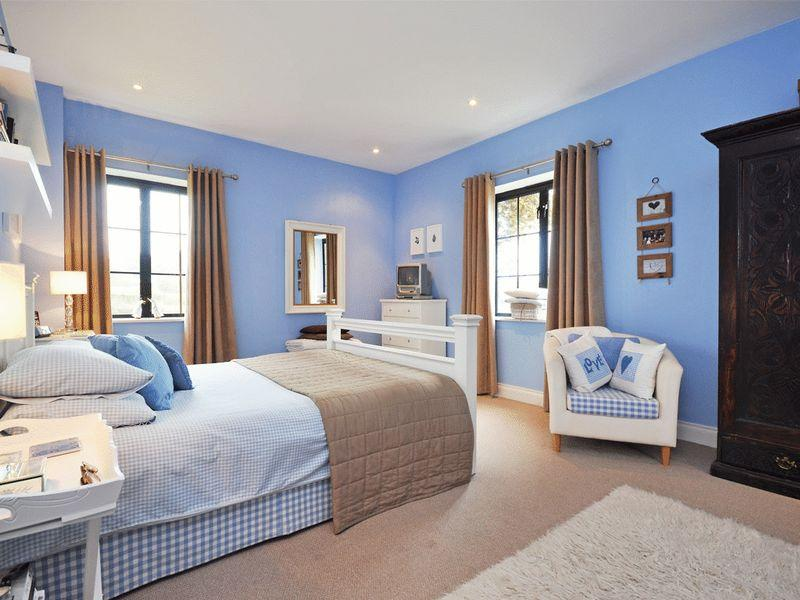 Click to see a larger image Blue and tan bedroom decorating ideas