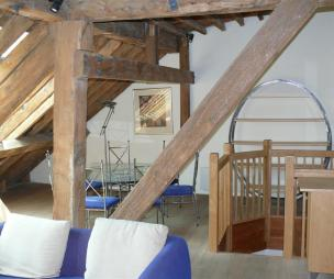 photo of beige white attic conversion loft conversion with exposed beams