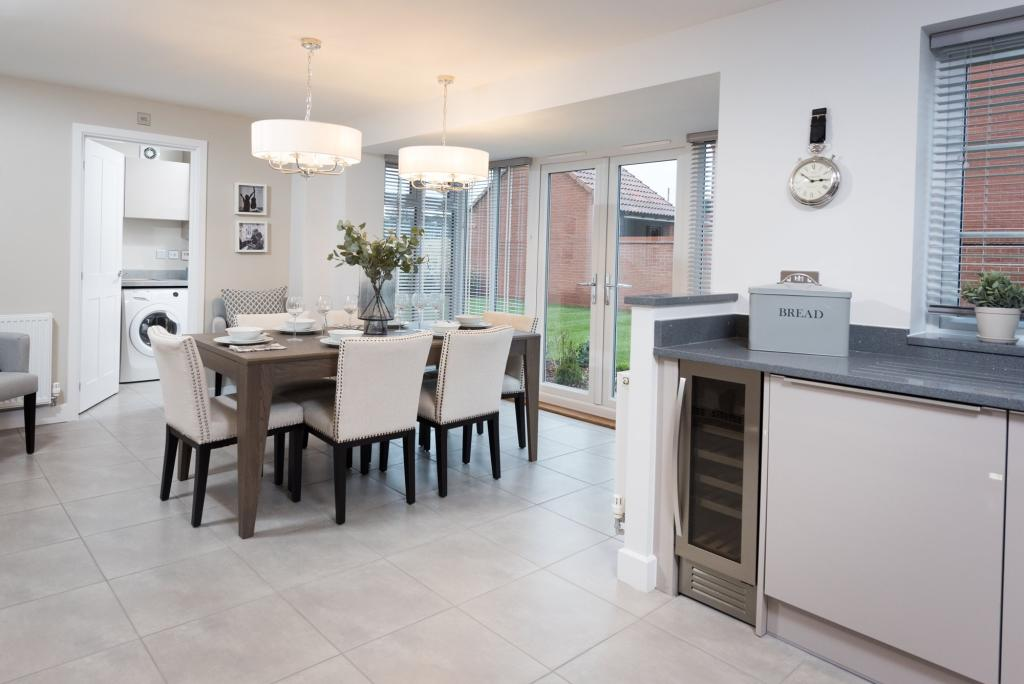 Kitchen with dining, utility room and French doors to garden