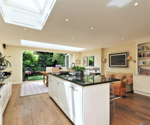 photo of bright open plan beige white white bifold doors oak family room kitchen with sliding folding doors kitchen island