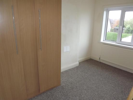 Bedroom with fitted cupboards
