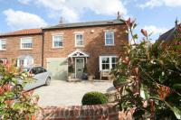 semi detached home in Main Street, Huby, YO61