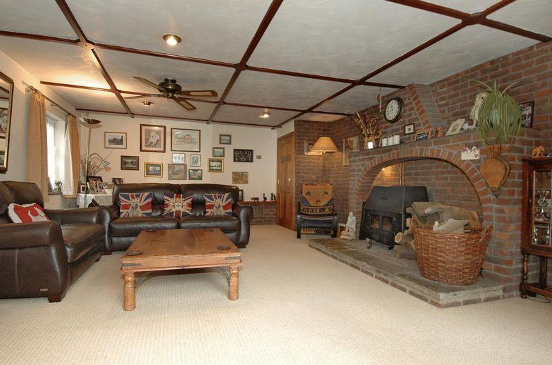 photo of beige brown living room lounge sitting room with ceiling fan brick fireplace union jack
