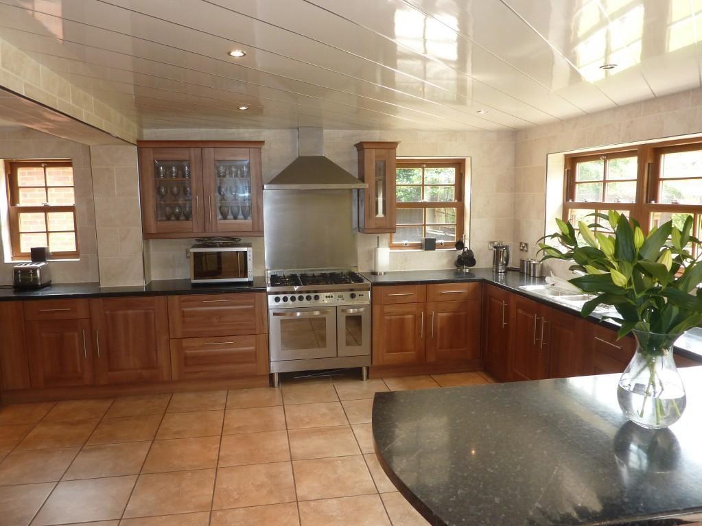 photo of beige brown kitchen kitchen diner