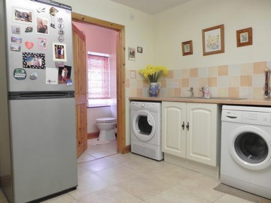 Utility showing toilet (Property Image)