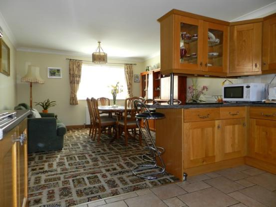 Kitchen to dining (Property Image)