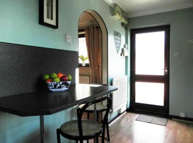 Kitchen to rear door [property images]