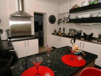 photo of american kitchen contemporary luxury open plan beige black red kitchen with breakfast bar