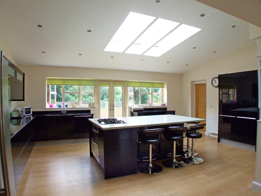 Click to see a larger image Contemporary open plan kitchen
