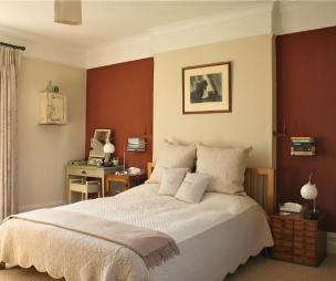 photo of natural beige brown chocolate bedroom double bedroom with feature wall