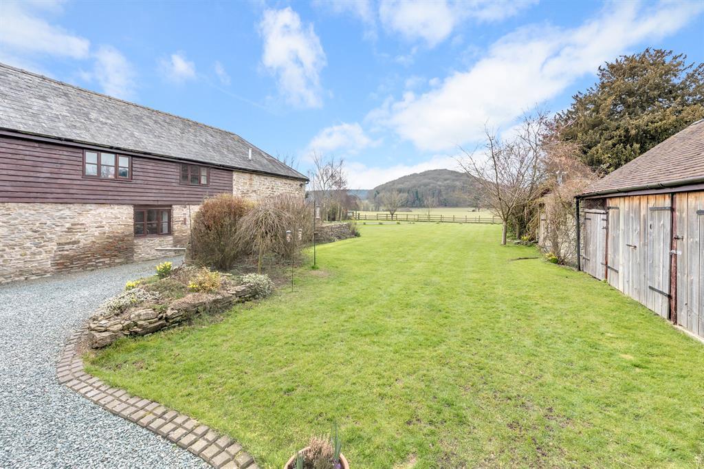 Front gardens, entrance and barn annexe plus garag