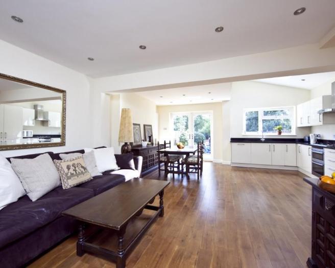 photo of open plan beige purple white kitchen living room lounge