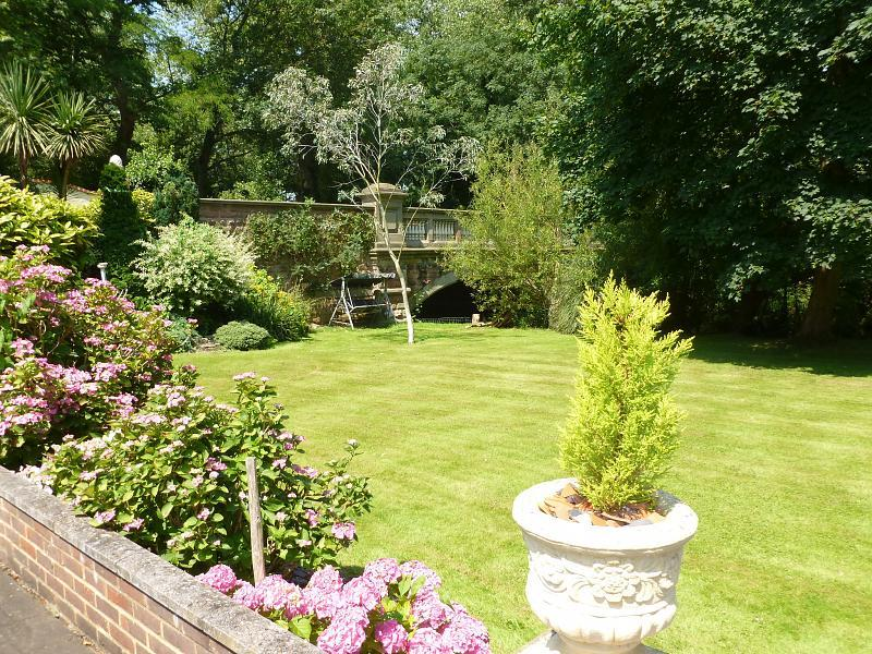 photo of garden with flowers and lawn