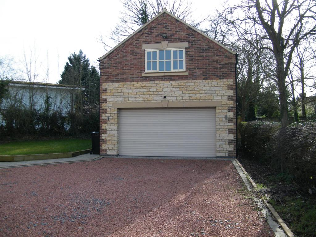 4 bedroom detached house for sale in rectory lane for Double garage with room above