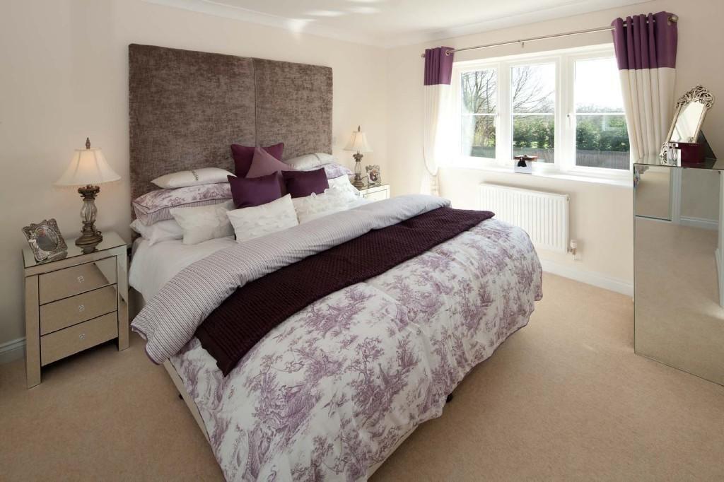 photo of beige brown purple white chrome bedroom and massive headboard
