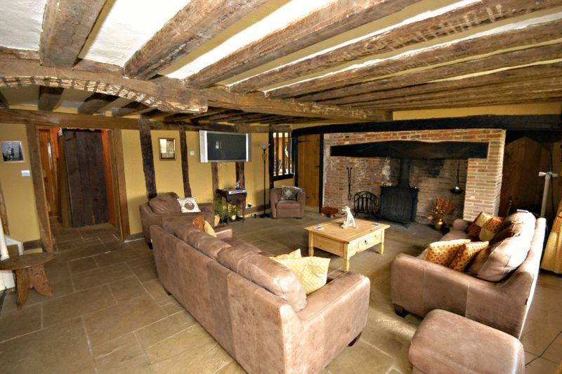 photo of rustic brown flagstones living room with exposed beams fireplace inglenook fireplace