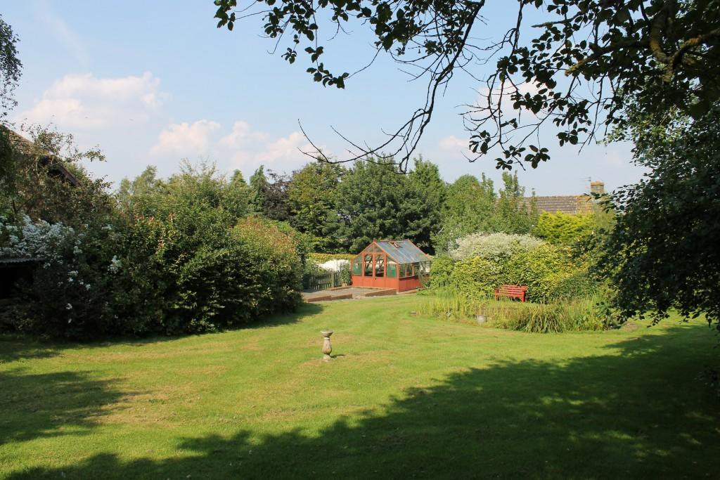 photo of garden gardens and patio pond potting shed