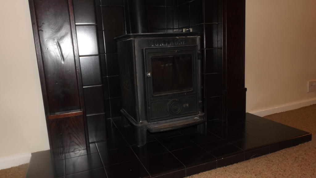 Traditional Log Burning Fireplace