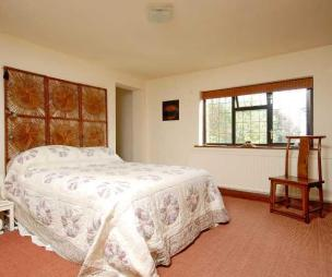 photo of beige orange bedroom with carpet