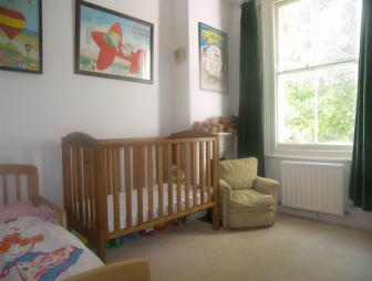 photo of brown white bedroom with sash window carpet