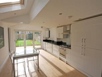 photo of beige white velux dining room kitchen kitchen extension with skylight