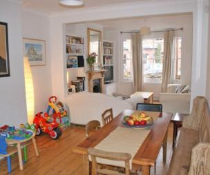 photo of open plan white timber living room and childrens furniture church pew furniture kids table and chairs pew