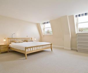 photo of beige white bedroom with carpet