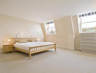 photo of textured beige white bedroom with carpet