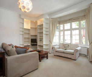 photo of beige white with shelves bay window