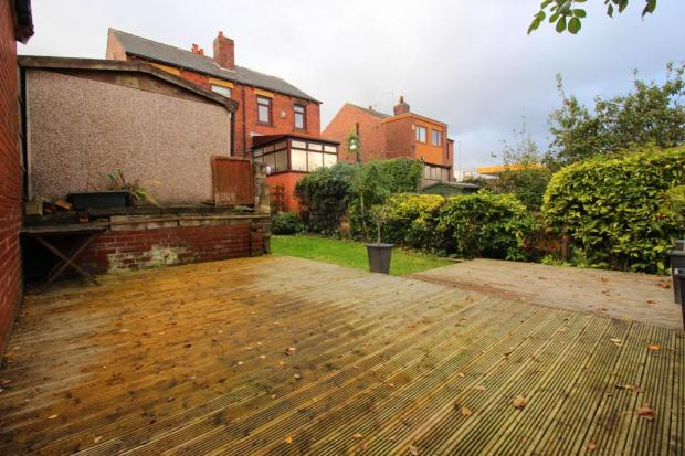 Large decked area and garden at the rear.