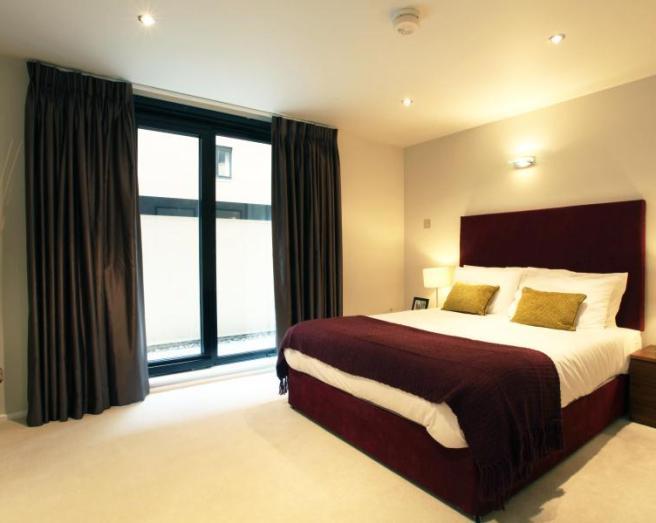 photo of beige brown purple bedroom with wine and furniture headboard
