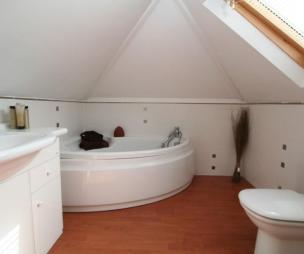 photo of beige white velux bathroom en-suite loft conversion with bath corner bath