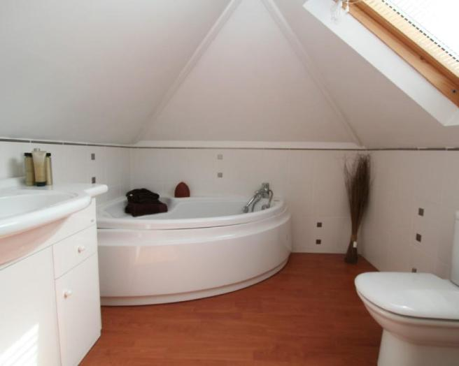 photo of beige white velux bathroom en-suite loft conversion with bath corner bath