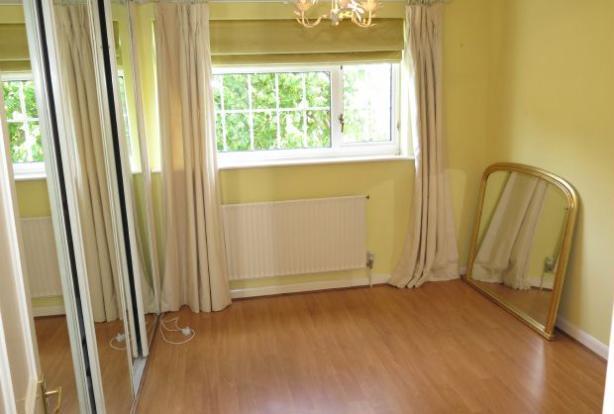 Bedroom 2 with extensive wardrobes
