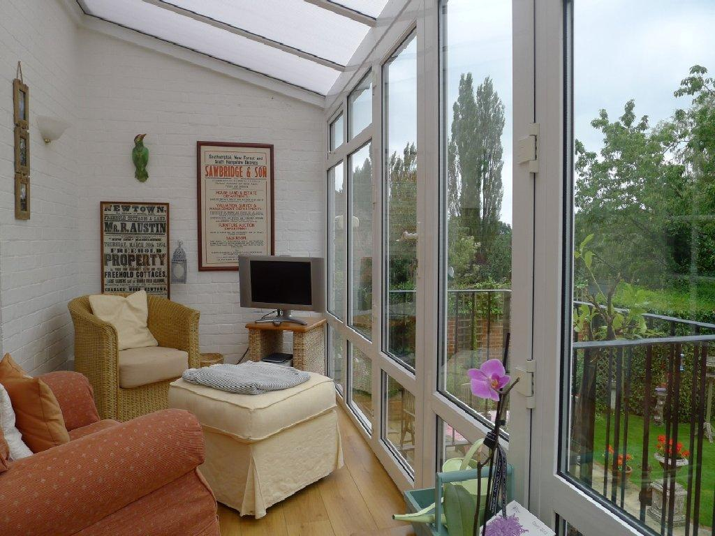 photo of green white conservatory